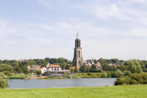 Dutch village with church on riverfront