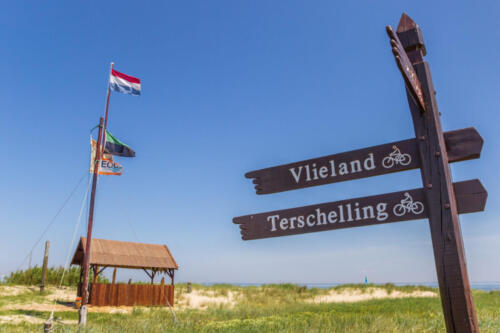 TEXEL, NETHERLANDS - JUNE 07, 2018: Signpost to the ferry from Texel island to Vlieland in the Netherlands